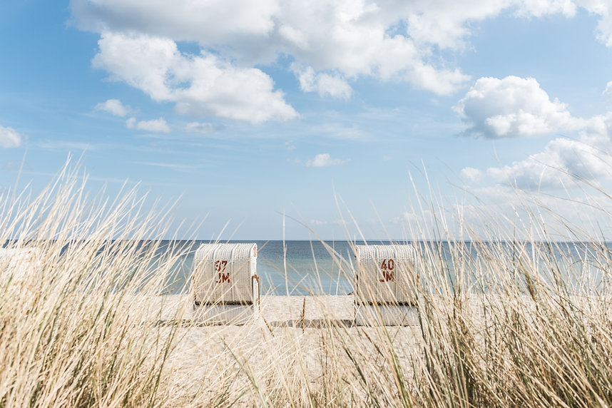 Two baltic sea beach chairs at famous holiday an camping area Scharbeutz having clear blue