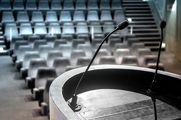 Podium empty auditorium microphone