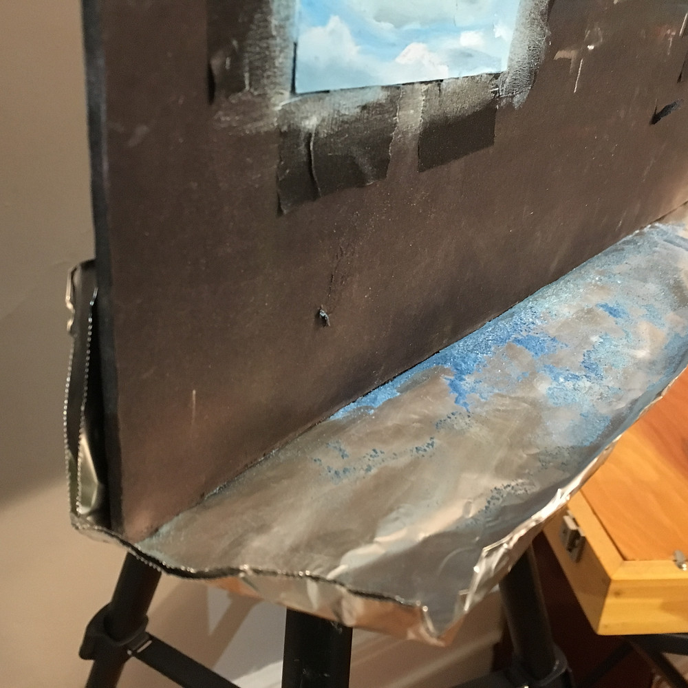 Easel showing pastel dust catcher in place.