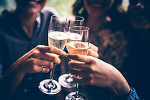 People cheering with wine glasses takes you to our reviews page