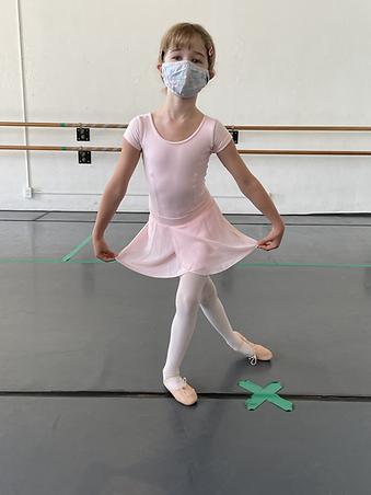 Curtsy girl w mask.HEIC