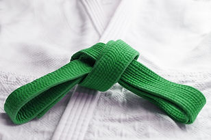 Green martial art belt tied in a knot on