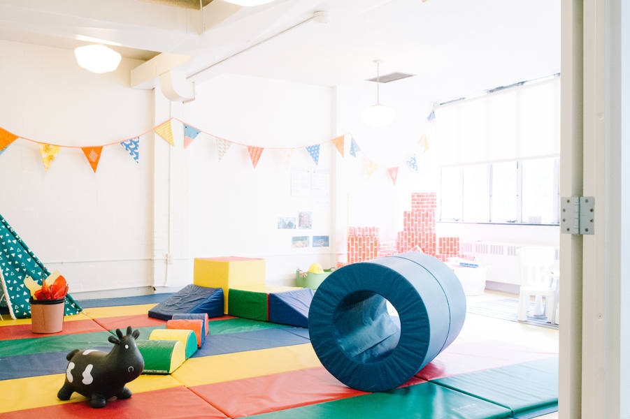 One of our classrooms has soft play mats for safe gross motor play.