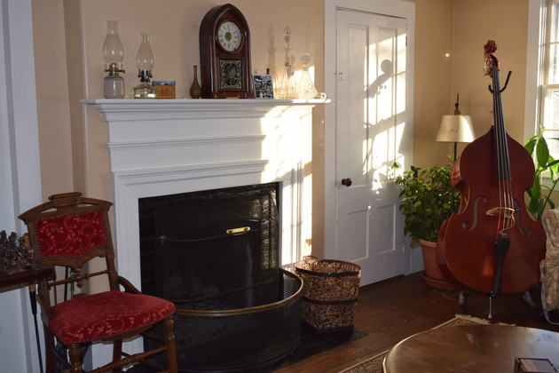 Fireplace and instruments in sitting room