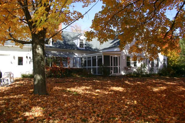 Uplands Inn front yard in fall with leaves and foliage