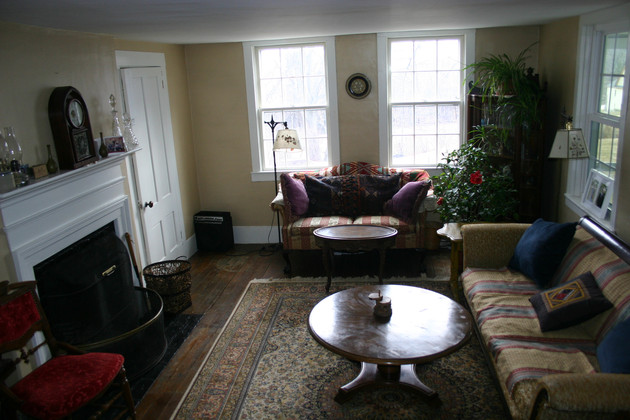 Bright, open sitting room with antiques