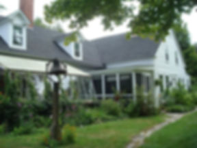 Front of historic farmhouse which is Uplands Inn_With porch and gardens