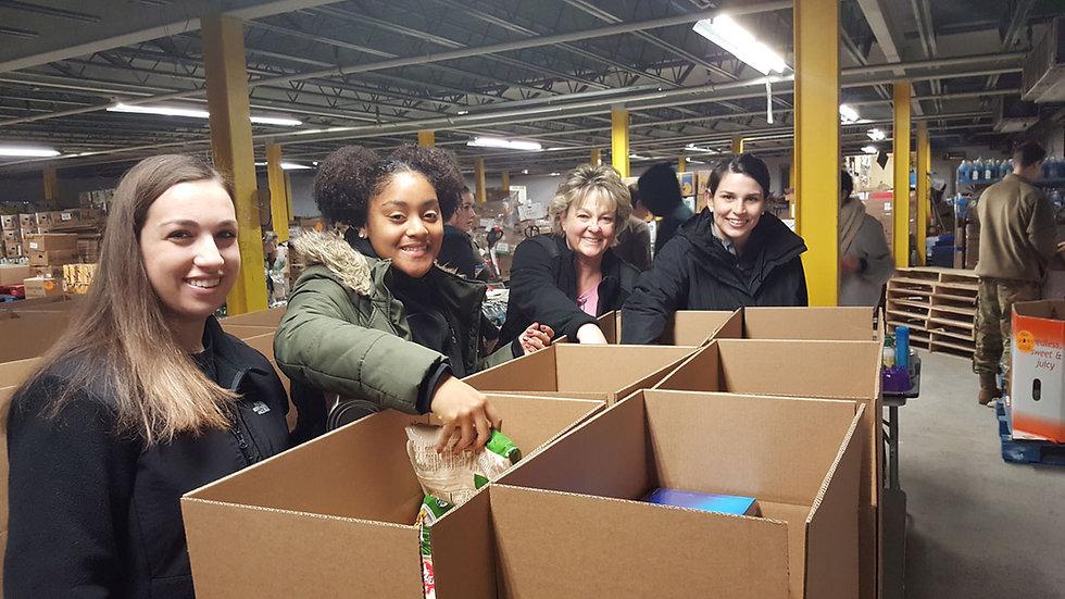 KW-volunteers-sorting-donations.jpg