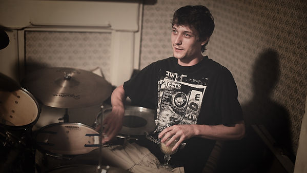 Charles partying behind drums.jpg