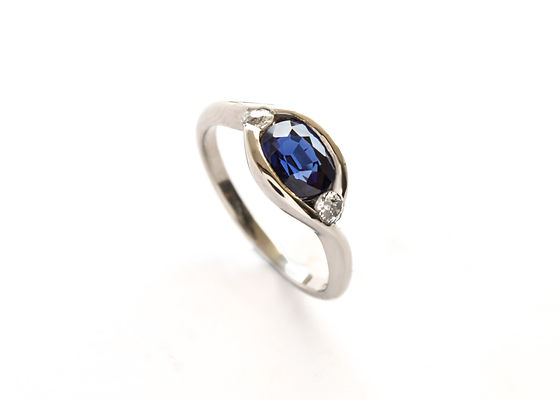 Oval Sapphire and Diamond Unusual twist engagement ring