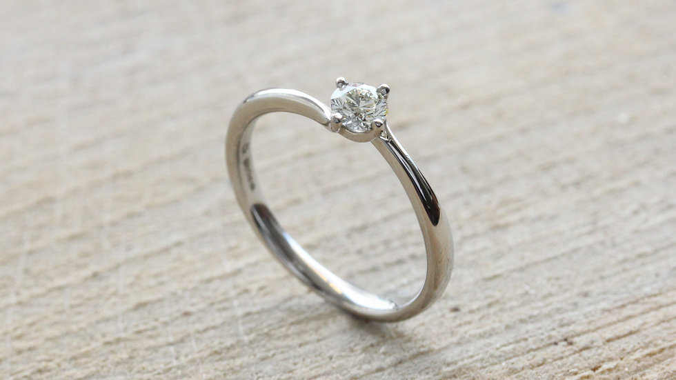 Twisting Platinum Solitaire Engagement Ring