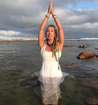Monet Viloen, (PhD), Jivamukti yoga teacher, integrative life coach, Tribal fusion belly dancer, Tantrika, and the creatrix of Shadow Illumination Yoga and Shakti Alchemy Goddess Evolution (SAGE).