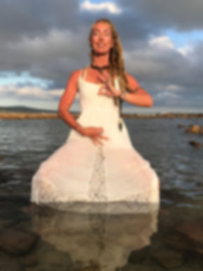 Shadow Illumination Yoga: Monet Viloen, (PhD), Jivamukti yoga teacher, integrative life coach, Tribal fusion belly dancer, Tantrika, and the creatrix of Shadow Illumination Yoga and Shakti Alchemy Goddess Evolution (SAGE).