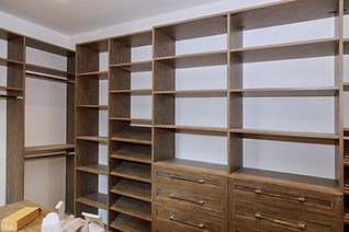 Large with in closet with many shelves a