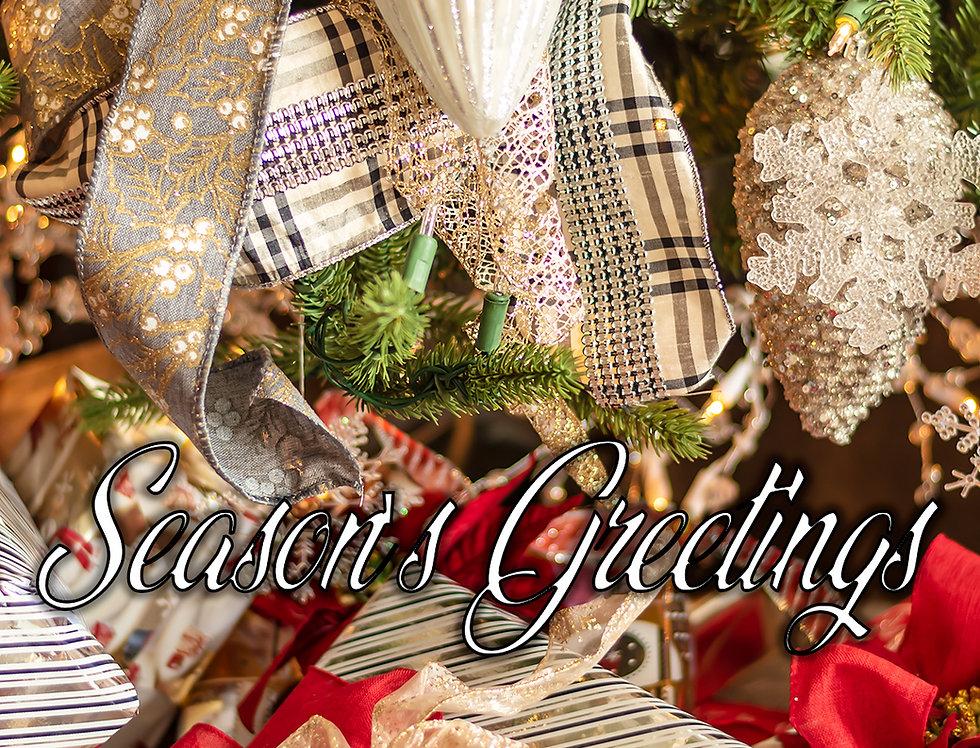 Season's Greetings gifts under tree