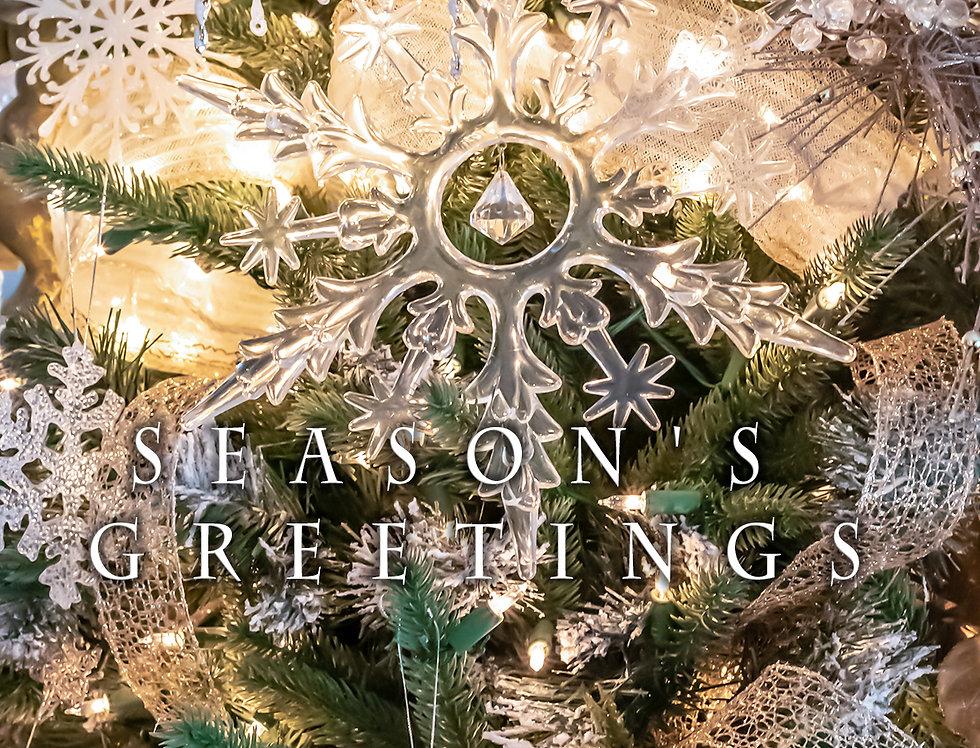 Season's greetings snow flake on tree