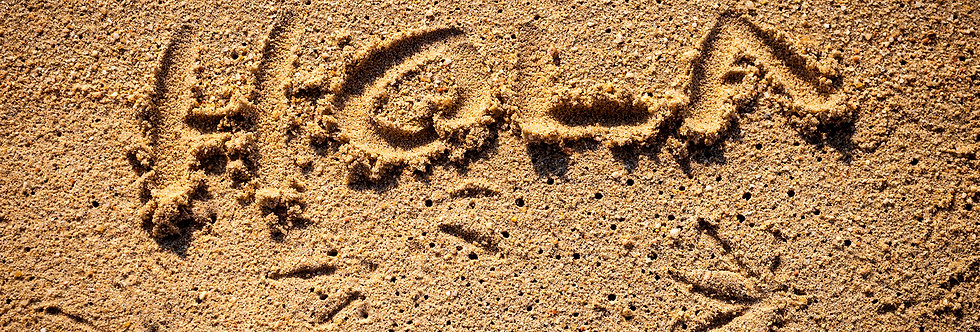 Hola in sand