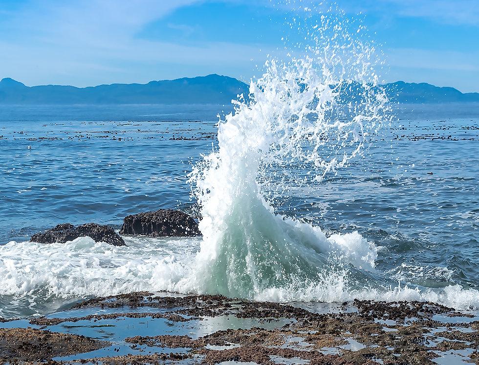 Crashing wave on beach