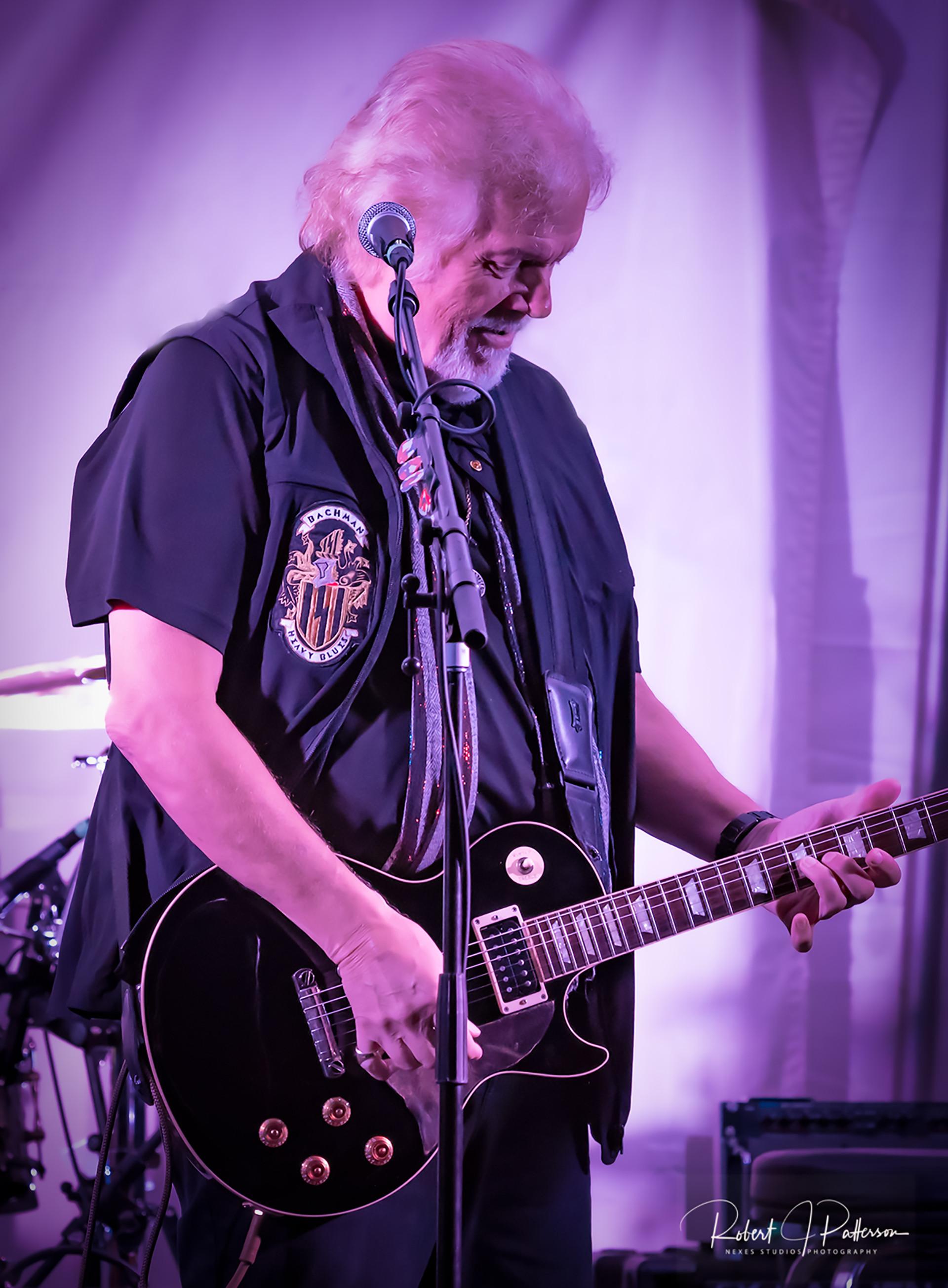 Randy tuning guitar.jpg
