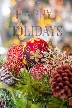 Happy Holidays Christmas balls close up.