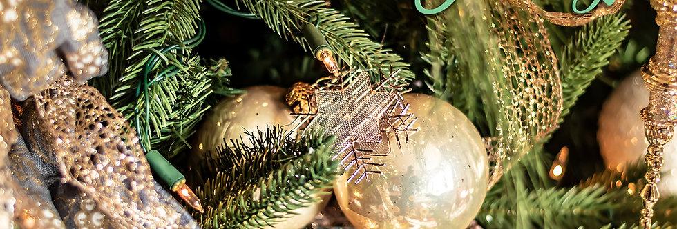 Season's greetings decorations on tree