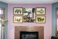 wall gallery of 4 custom framed portraits and one whitmire canvas in the middle. Family of 4 in the middle portrait and varying groupings in the 4 framed portraits.