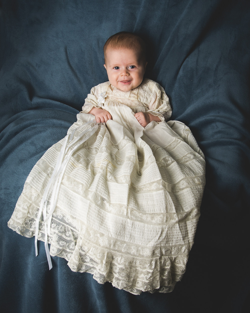 Christening Portrait in Christening Gown taken by Madelin Zaycheck of Memory Me Studio in St. Paul, Minnesota