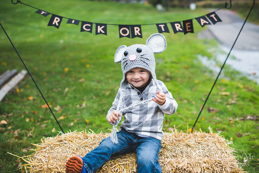 Cute little boy dressed in a mouse costume at a trick or treating even in North St. Paul, MN. Portrait captured by Madelin Zaycheck, St. Paul Family Photographer