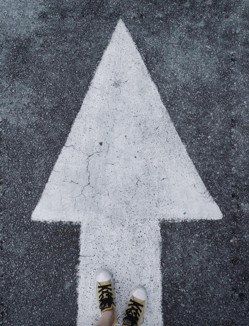 Direction, forward, feet on arrow, onwards, decisions, choosing life
