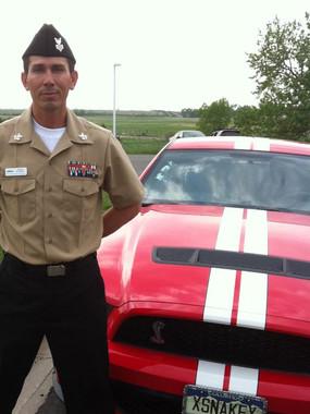 Petty Officer Snake Blocker next to his Cobra
