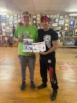 David Tice Presenting Snake Blocker with Black Belt Certificate (American Combat Jiu-Jitsu & Catch W
