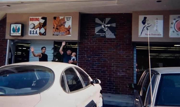 Snake Blocker and Robert Pohl holding Logan Pohl at Blocker Academy of Martial Arts, Palos Verdes, California