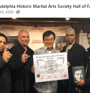 Jackie Chan receives his PHMAS Hall of Fame Inductee Certificate