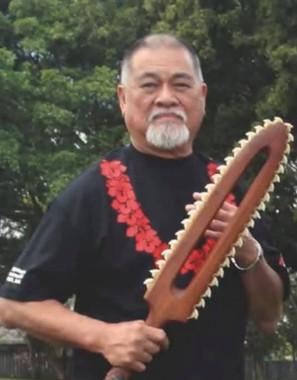 Sifu Richard Bustillo holding Hawaii weapon made by Sifu Kainoa Li