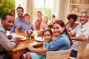Family and friends sitting at a dining t