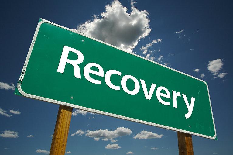 Recovery Road Sign with blue sky and clo