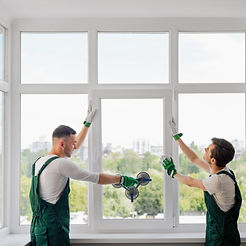 Construction workers install a window_edited.jpg