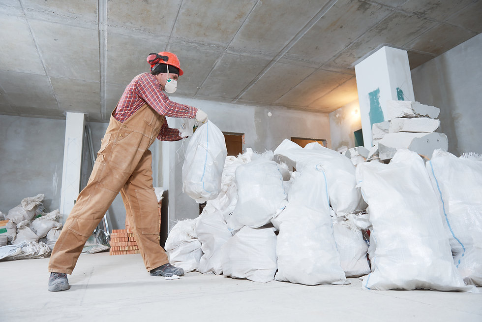 Worker collecting construction waste in