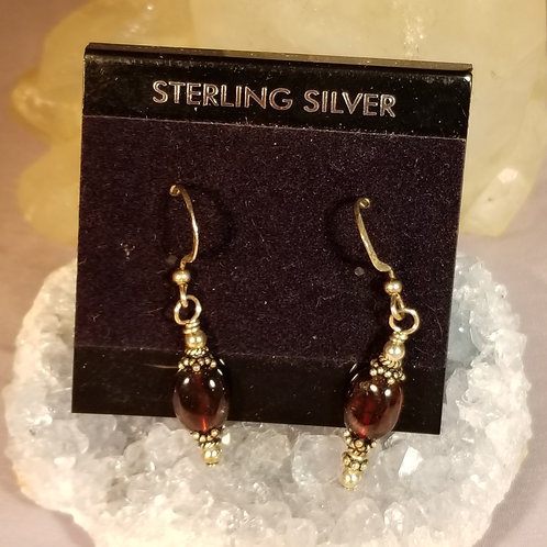 Earrings:  Garnet in sterling silver
