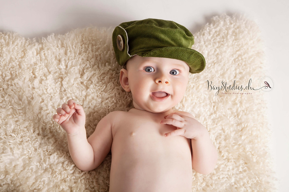 A sweet baby boy visited me in my studio with his parents to save some funny moments of his happy babyhood. He made my day with his adorable smile and blue eyes.