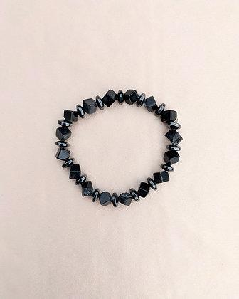 A stretch bracelet made from Black Onyx druzy cubes and hematite.