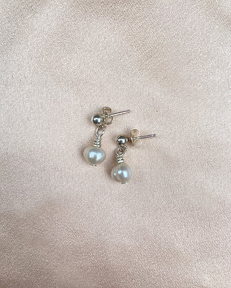 White freshwater pearl earrings on sterling silver studs, front view.