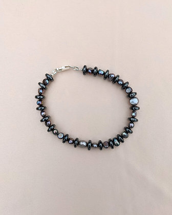 An anklet or bracelet made from peacock pearls and hematite.