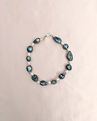A bracelet made from pearls and marble dip dyed baroque pearls.