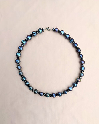 A necklace made from hematite and ringed peacock pearls