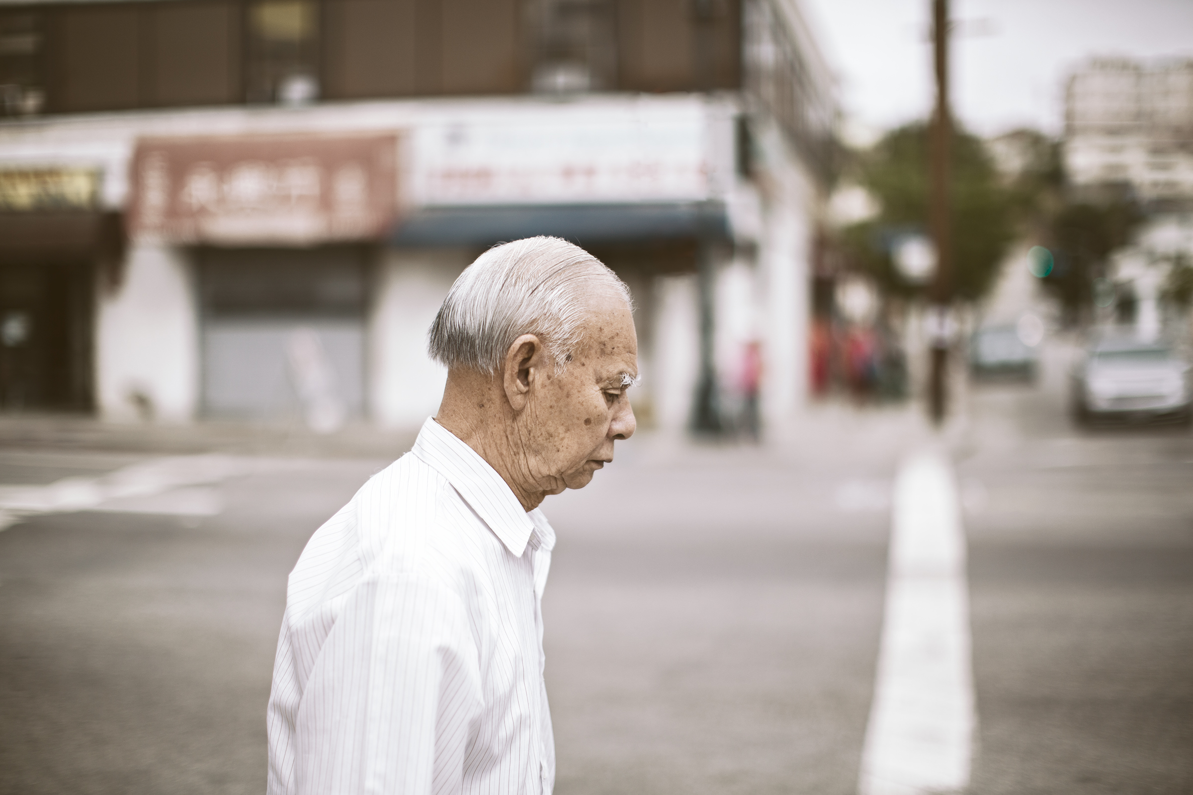 Old Asian Man Standing at Corner 20130623