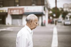 Old Asian Man Standing at Corner 20130623