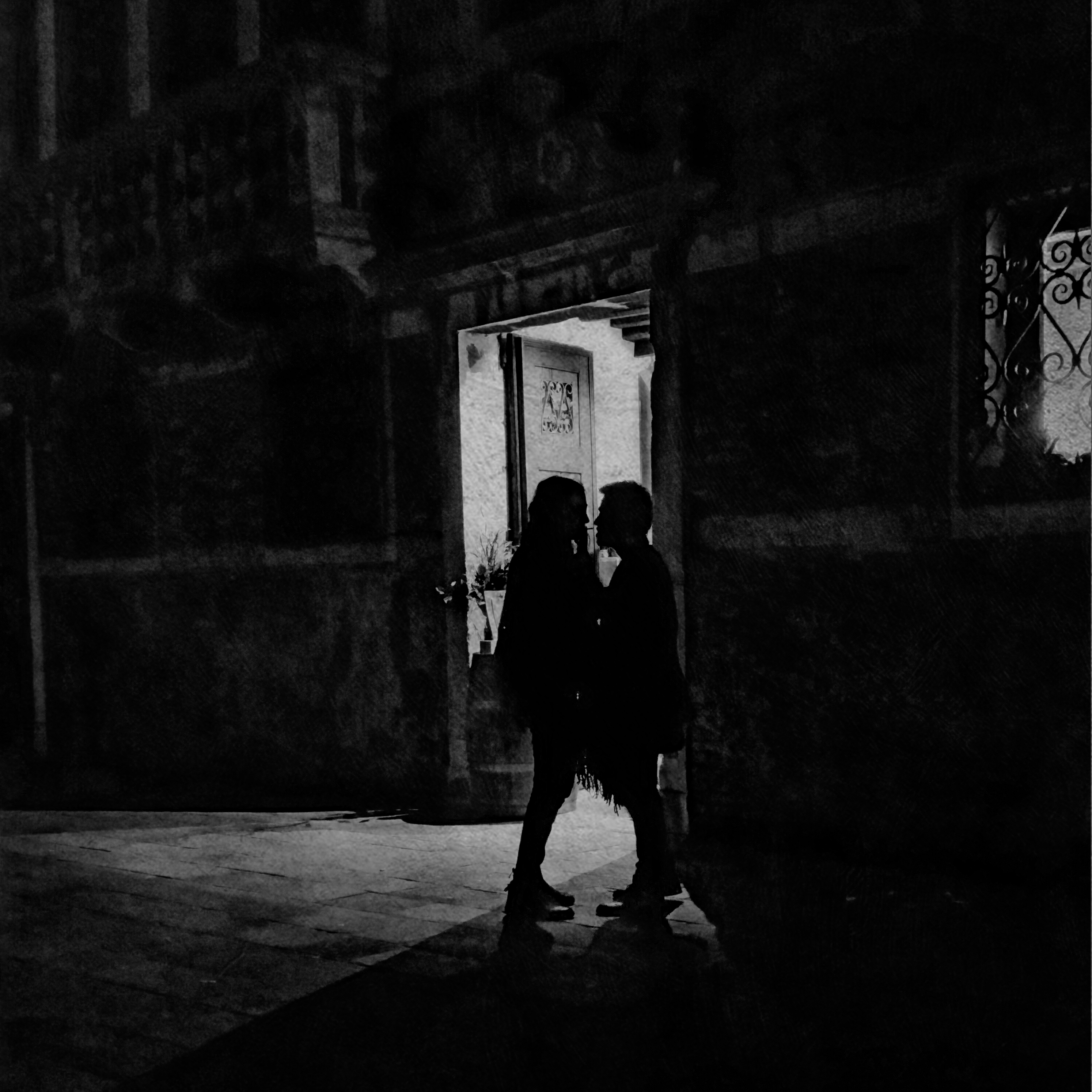 Couple Standing Outside of a Bar