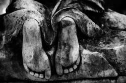 Feet of Kneeling Person