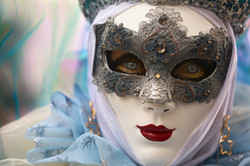 Performer in Silver Mask